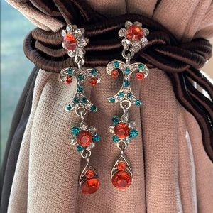 Silver with blue and red gems dangly earrings
